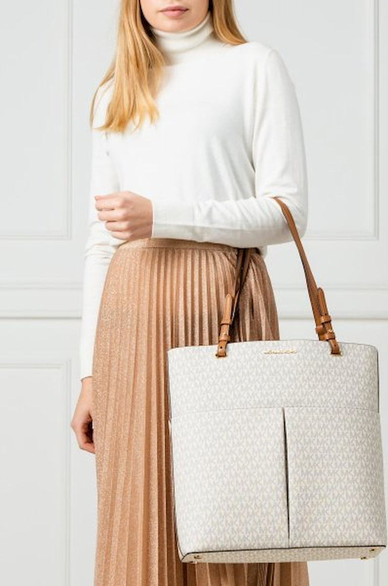 woman wearing leather tote bag