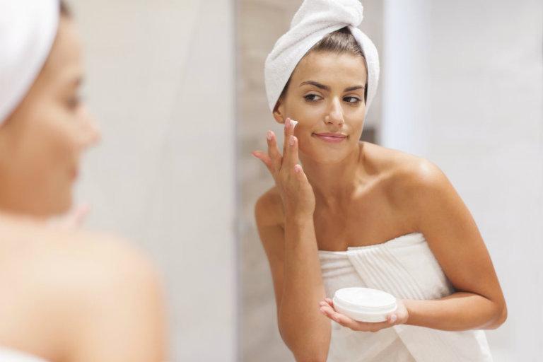beautiful girl taking care of her skin