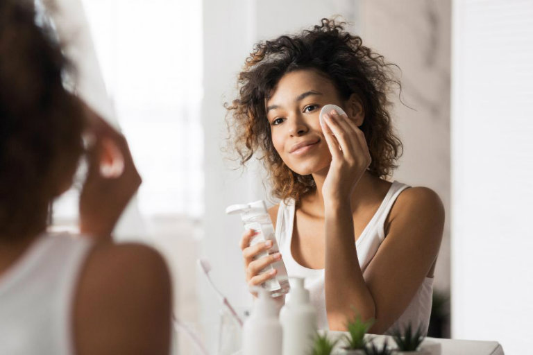 young-woman-using-face-cleanser-for-black-skin-care