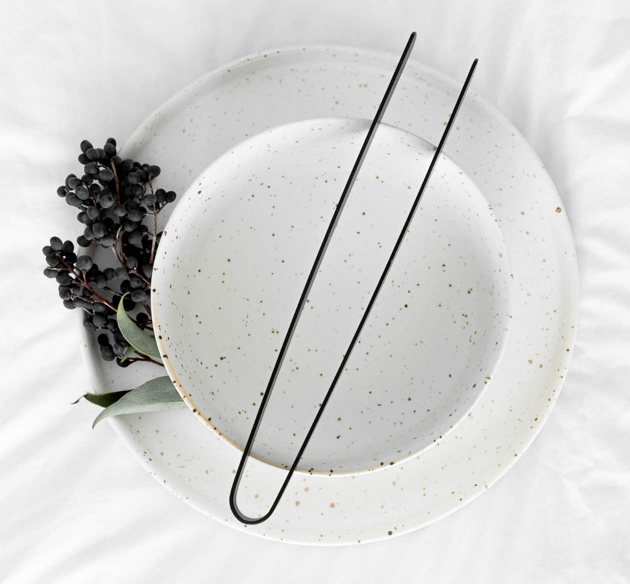 ceramic plate and kitchen tongs