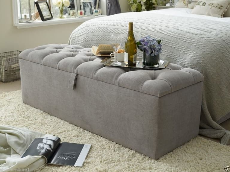 grey ottoman as a storage box for bedroom