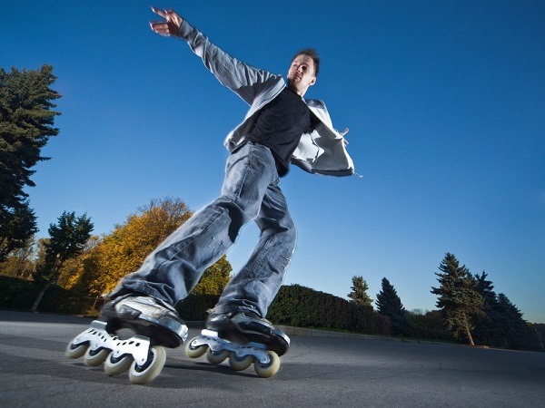 picture of a man with roller skates on the street