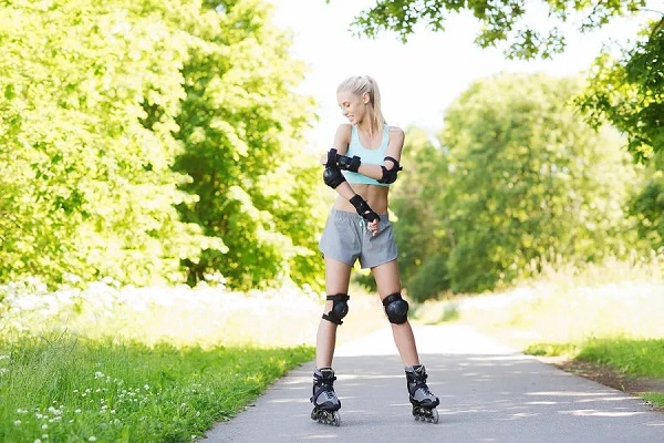 picture of girl in park on roller skates and with protection