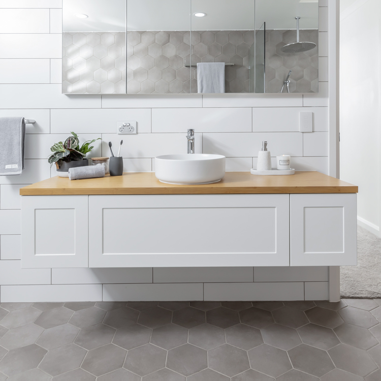 vanity basin and additional storage cabinets