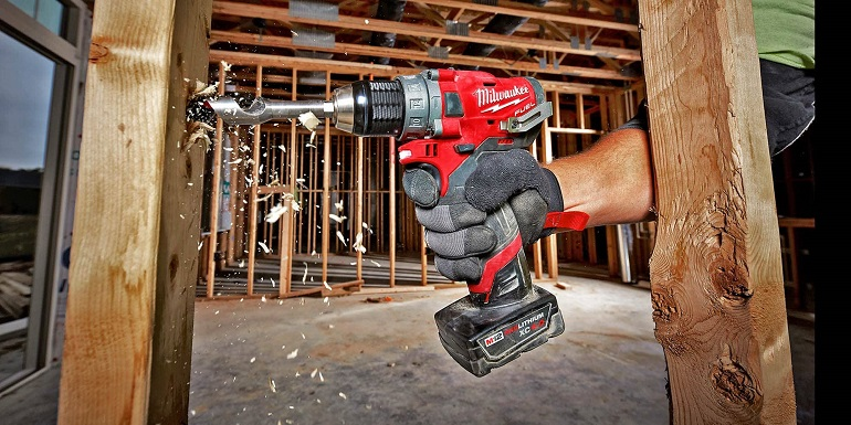 Close-up of working with milwaukee power drill