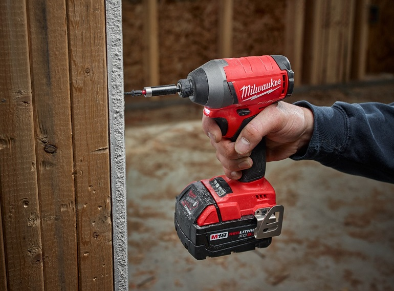 Close-up of working with milwaukee m18 fuel impact driver