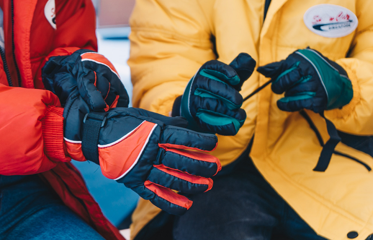 Putting on snow gloves