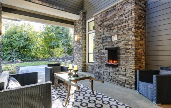 Well designed covered patio boasts stone