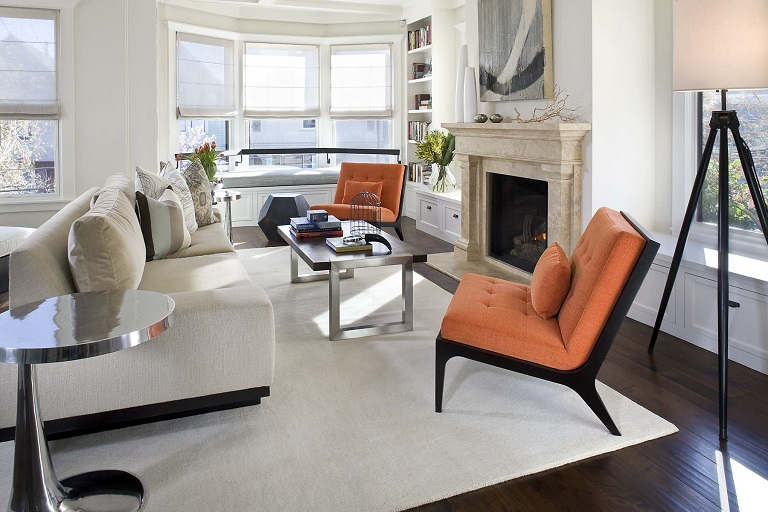 Orange accent chairs in a living room
