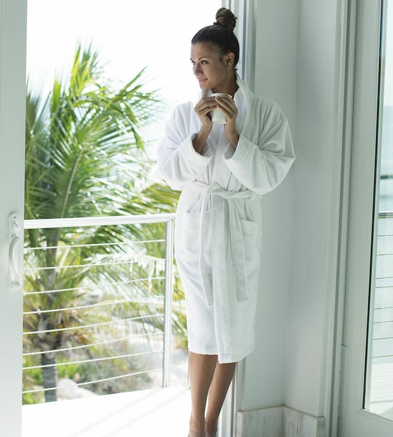 Girl drinking coffee and wearing a white bamboo robe
