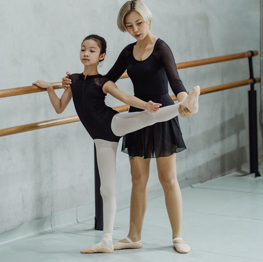 picture of a woman and a little girl dancing ballet in a dance studio