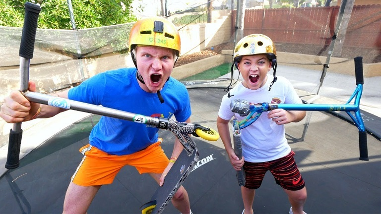 boys having fun with trampoline scooters