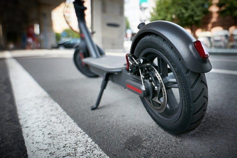 scooter wheels and deck on street